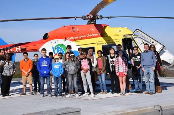 """Children Need Children's,"" KIDS Georgia members tour Children's Healthcare of Atlanta's medical helicopter, a flying pediatric ICU. Credit: Hunter Darsey, KIDS Georgia Photographer"