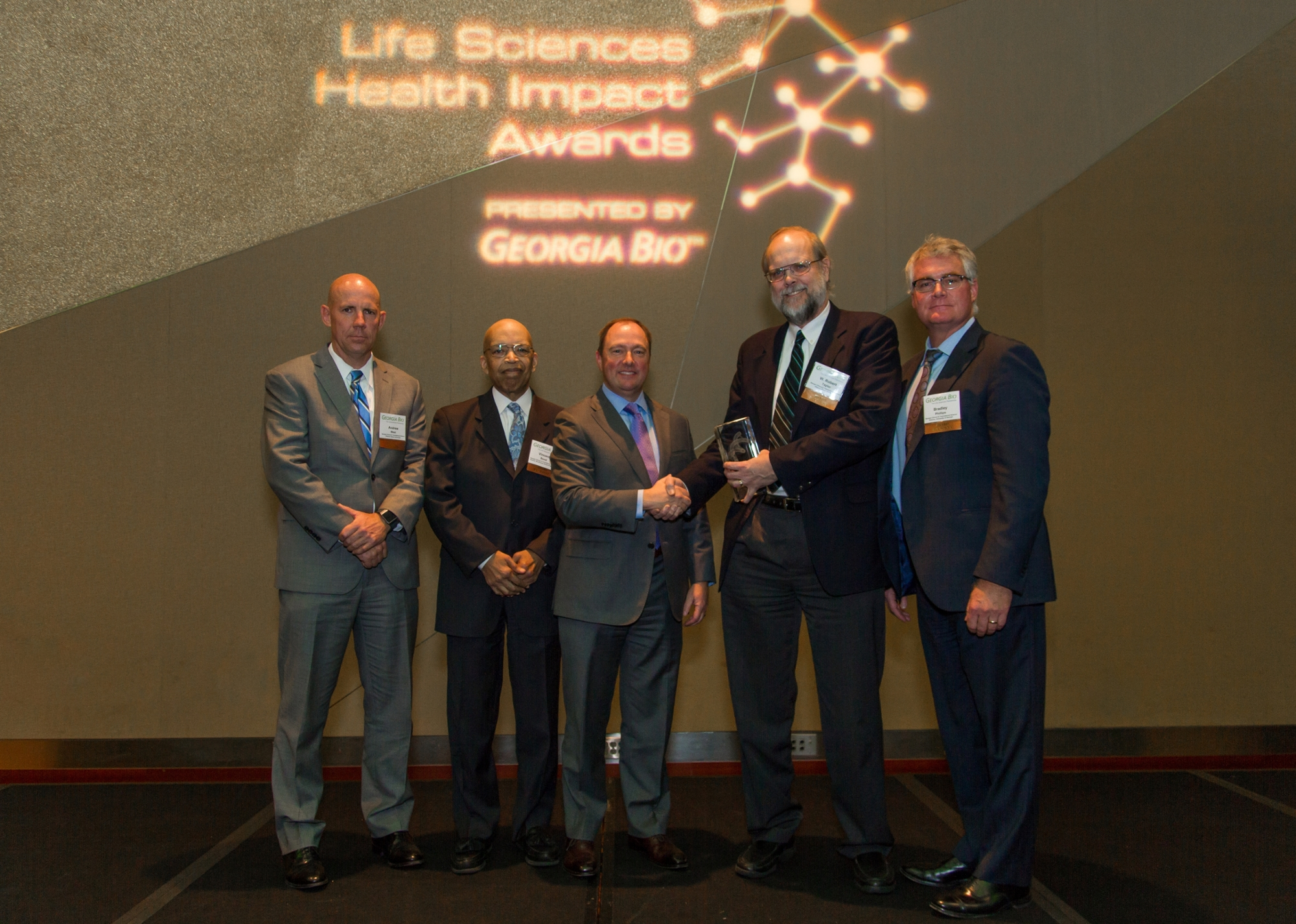 Georgia CTSA leaders accepting the award from Georgia Bio President