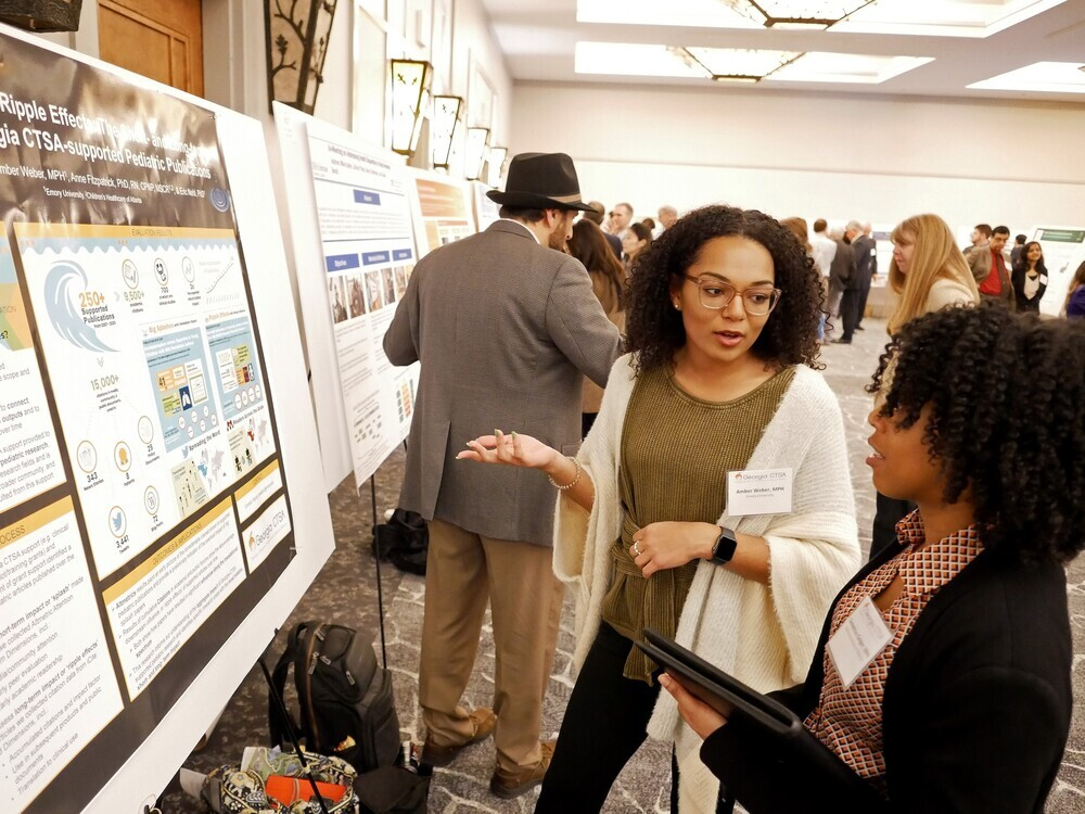 researchers presenting posters