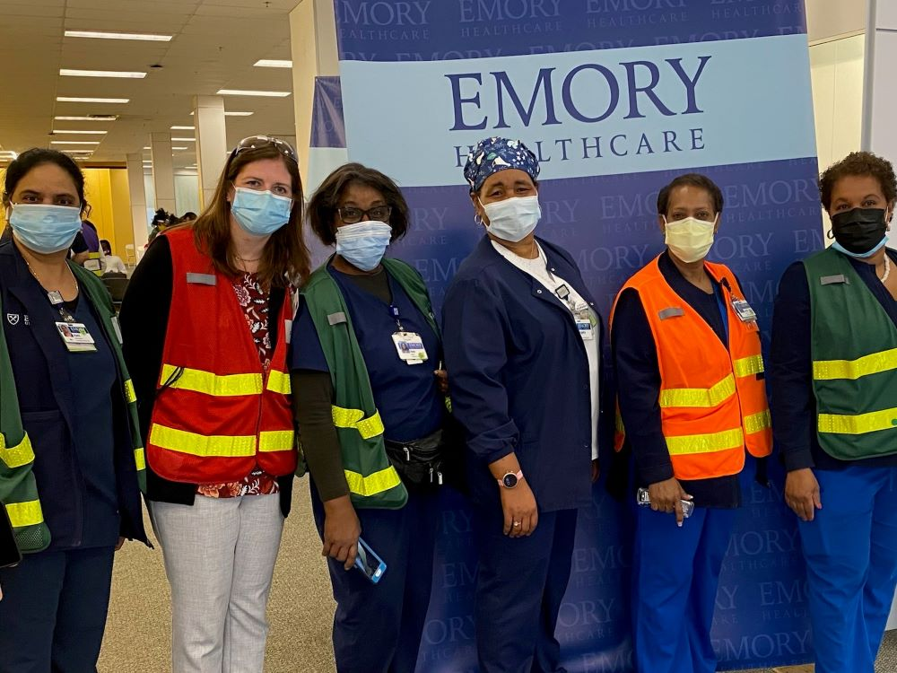 clinicians wearing face masks and protective vests