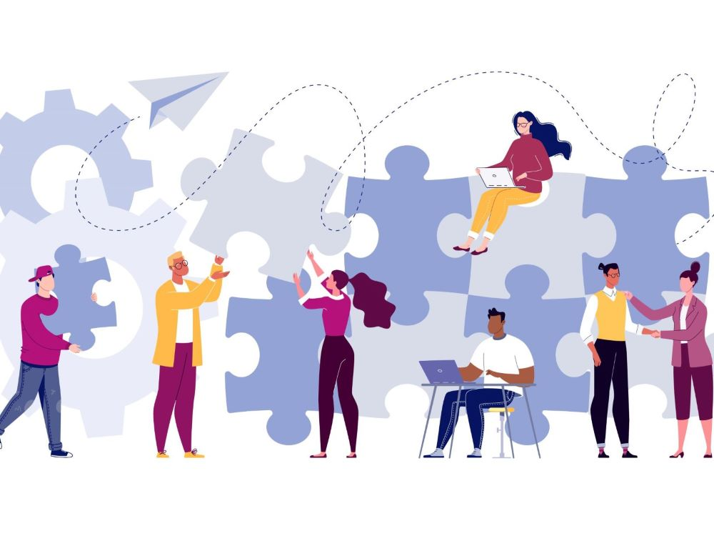 illustration of team completing a puzzle